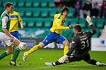 Hibs v St Johnstone...21.01.12.Mark Brown blocks Fran Sandaza's shot at goal.Picture by Graeme Hart..Copyright Perthshire Picture Agency.Tel: 01738 623350  Mobile: 07990 594431