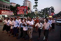 National League for Democracy (NLD) supporters, celebrate as they march from their party HQ to Aung San Suu Kyi's home following her release from house arrest in Rangoon. From 1990 until her release on 13 November 2010, Aung San Suu Kyi had spent almost 15 of the 21 years under house arrest.