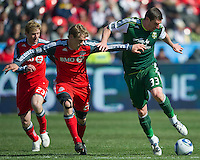 26 March 2011:Portland Timbers forward Kenny Cooper #33 and Toronto FC defender Ty Harden #20  in action during an MLS game between the Portland Timbers and the Toronto FC at BMO Field in Toronto, Ontario Canada..Toronto FC won 2-0....