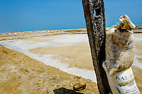 Sacks of salt seen next to the mined-out salt lagoon in Salinas de Manaure, Colombia, 12 May 2007. Manaure, the arid region in northern most part of South America (Guajira Peninsula), with its very hot and dry climate throughout the year and with the naturally formed lagoons, has always been favorable for the salt production. The salt explotation, run in this area by the Wayuu Indians and later by Colombian mestizos, is known since the pre-Columbian era. Although nowadays the salt production reach to one million tons a year, processed both by industrial and artisanal methods, no social or economical development has been marked in the local community. Sea salt industry in Manaure covers the major part of Colombia's salt consumption.