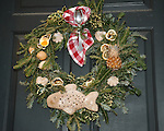"Christmas wreath Colonial Williamsburg Virginia, wreath, Colonial Williamsburg Virginia is historic district 1699 to 1780 which made colonial Virgnia's Capitol, for most of the 18th century Williamsburg was the center of government education and culture in Colony of Virginia, George Washington, Thomas Jefferson, Patrick Henry, James Monroe, James Madison, George Wythe, Peyton Randolph, and others molded democracy in the Commonwealth of Virginia and the United States, Motto of Colonial Williamsburg is ""The furture may learn from the past,"""
