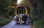 Leslie and Edna, English Romanies, leading their horse an wagon along the backroads their family have travelled on for generations. Heading back home after the Stow and Wold horse fair. Cotswolds, England 1996