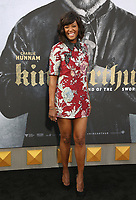 """HOLLYWOOD, CA - May 8: Aisha Tyler, At Premiere Of Warner Bros. Pictures' """"King Arthur: Legend Of The Sword"""" At The TCL Chinese Theatre In California on May 8, 2017. Credit: FS/MediaPunch"""