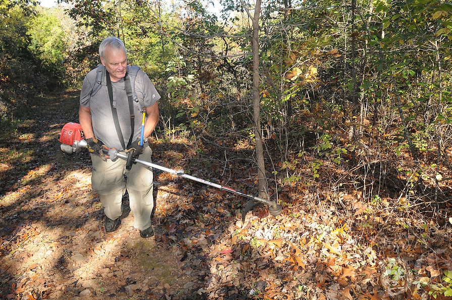 NWA Democrat-Gazette/FLIP PUTTHOFF <br /> Tom Waggoner trims vegetation Oct. 21 2016 along the trail to Sweden Creek Falls.
