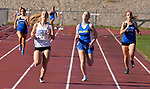 WINSTED, CT-041817JS04- Litchfield's Amber Marino and Gilbert's Grace Amber Valickis battle to the finish line in the 400M run during their meet  with Lewis Mills Tuesday at Northwest Regional High School in Winsted. Marino won the race. <br /> Jim Shannon Republican-American