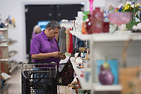 NWA Democrat-Gazette/J.T. WAMPLER Danny Rodriguez of Bentonville shops Thursday April 13, 2017 at Rogers Samaritan Shop's new location at the old Rogers Outdoor Sports location at 2115 W. Walnut in Rogers. The store has had record sales days since opening last Saturday.