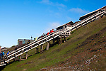 Tourists ascend the 220 steps to Barentsburg, a Russian coal mining town in the Norwegian Archipelego of Svalbard. Once home to about 2000 miners and their families, less than 500 people now live here.