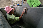 Antonio Sacorate constructs a septic tank in Bacubac, a seaside neighborhood in Basey in the Philippines province of Samar that was hit hard by Typhoon Haiyan in November 2013. The storm was known locally as Yolanda. Norwegian Church Aid, a member of the ACT Alliance, is sponsoring the construction of bathrooms with septic systems for houses in the village where existing systems were destroyed by the typhoon's unusually high storm surge.