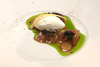 "The dish of Eggplant with ""celery coal"": Spruce needle vinegar, mint at the Restaurant Horváth, Berlin, Germany. Photo Sydney Low"