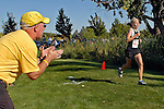 Capital coach John Doherty encourages Julia Taylor during the NNU Invite at West Park in Nampa, ID on September 11, 2010. Taylor, Capital's top finisher, posted a time of 19:27.30 to finish ninth.