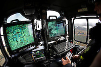 Norwegian Police Helicopter <br /> System Opreator Lasse Iversen controlling the various camera and map systems on board the helicopter.