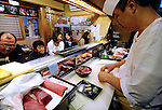 Masahito Ito prepares a bowl of fresh tuna on rice at Hama Zushi sushi restaurant in Oma, northern Japan on 23 September 2008. Oma has long been synonymous with high-quality tuna in Japan, and a bowl of rice with six slices of tuna costs around 3,400 yen. .Photographer: Robert Gilhooly