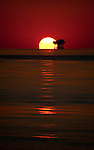 Sunset behind oil platform in the Gulf of Mexico