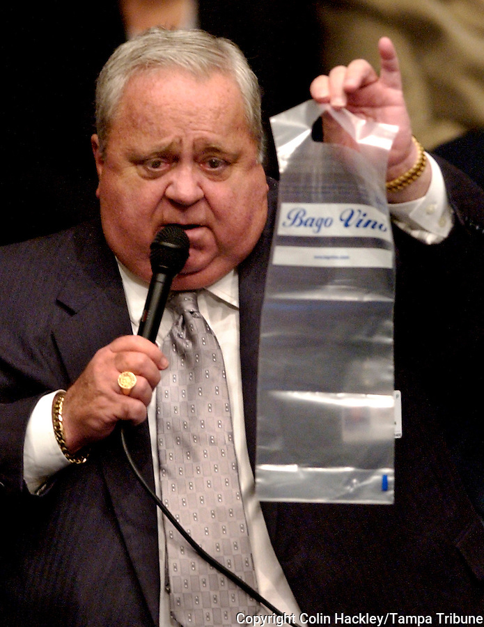 TALLAHASSEE, FL. 4/6/05-Sen. Jim King, R-Jacksonville, holds a plastic bag that restauranteurs could use to seal wine purchased and opened at their establishments for transport to a customer's home, Wednesday at the Capitol in Tallahassee. COLIN HACKLEY PHOTO