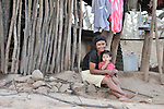 Adriana Alvarez and a son in front of her home in La Pacaira, a small village in northwestern Nicaragua.