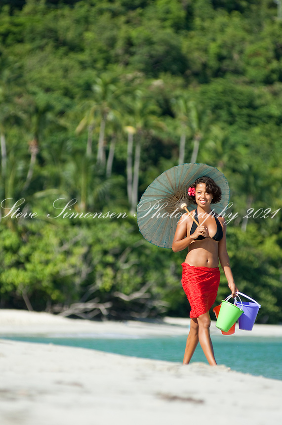 Alexa Putnam with sarong and parasol<br /> Cinnamon Bay<br /> Virgin Islands National Park