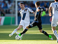 Stanford, California - Saturday June 30, 2012: Robbie Keane and Sam Cronin fighting for the ball during a game at Stanford Stadium, Stanford, Ca.San Jose Earthquakes defeated Los Angeles Galaxy,  4 to 3