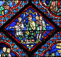 Noah cursing Ham and his son Canaan, from the Life of Noah stained glass window, 13th century, in the nave of Chartres cathedral, Eure-et-Loir, France. Chartres cathedral was built 1194-1250 and is a fine example of Gothic architecture. Most of its windows date from 1205-40 although a few earlier 12th century examples are also intact. It was declared a UNESCO World Heritage Site in 1979. Picture by Manuel Cohen