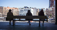 Travelers wait for the J train at the Myrtle Avenue station in the Bushwhack neighborhood of Brooklyn in New York on Saturday, April 25, 2015.  (© Richard B. Levine)