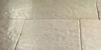 Solid Natural Limestone Tiles of a very consistent composition, with straight cut, slightly pillowed edge, naturally undulated, high honed surface. Shown in a highly variegated Beige. Please call for color and size availability.