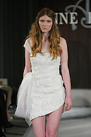 Model walks runway in a Janis wedding dress by Anne Bowen, for the Anne Bowen Bridal Spring 2012 runway show.