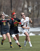 Boston College midfielder Sarah Mannelly (6) brings the ball forward as University of Maryland midfielder Beth Glaros (20) defends..University of Maryland (black) defeated Boston College (white), 13-5, on the Newton Campus Lacrosse Field at Boston College, on March 16, 2013.