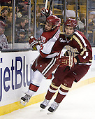 Danny Biega (Harvard - 9), Travis Jeke (BC - 8) - The Boston College Eagles defeated the Harvard University Crimson 4-1 in the opening round of the 2013 Beanpot tournament on Monday, February 4, 2013, at TD Garden in Boston, Massachusetts.