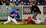 5 March 2012: New York Mets infielder Vinny Rottino gets Brett Carroll out stealing 3rd during a Spring Training game against the Washington Nationals at Digital Domain Park in Port St. Lucie, Florida. The Nationals defeated the Mets 3-1 in Grapefruit League play. Mandatory Credit: Ed Wolfstein Photo