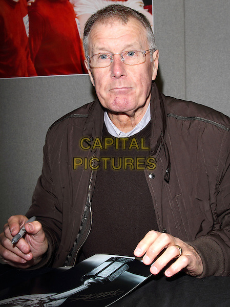 Sir Geoff Hurst.Celebrities and Sporting Greats attend 'Collectormania 19' at stadium:mk, Milton Keynes, Bucks, UK, May 25th 2013..half length pen glasses brown .CAP/JIL.©Jill Mayhew/Capital Pictures..