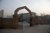 A gate built to resemble Turkish-style architecture stands at the entrance of the Hotel Seman parking lot in Kashgar, Xinjiang, China.