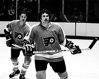 Philadelphia Flyers #8 Dave Schultz, & #5 Larry Goodenough. ( 1975 photo/Ron Riesterer)