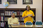 Sharon Mitchell (standing) of the School Advisory Council of Fulton Elementary presents a proposal. (Bas Slabbers/for NewsWorks)