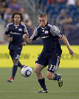 New England Revolution forward Zak Boggs (33) brings the ball forward. In a Major League Soccer (MLS) match, the Philadelphia Union defeated the New England Revolution, 3-0, at Gillette Stadium on July 17, 2011.