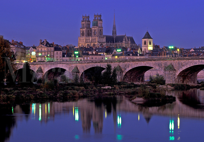Loire Castle Region, France, Orleans, Loire Valley, Loiret, Centre, Europe, Reflection of the town of Orleans and the stone bridge in the Loire River in the evening.