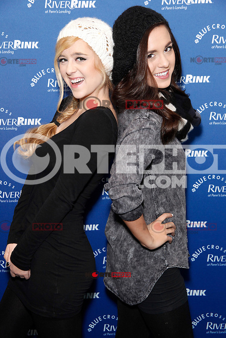 PHILADELPHIA, PA - NOVEMBER 23 :  Megan and Liz pictured at a ribbon cutting for Blue Cross River Rink and a free Q102 Jingle Ball Preview Concert at Blue Cross River Rink in Philadelphia, Pa on November 23, 2012  © Star Shooter / MediaPunch Inc /NortePhoto