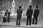 Men looking in a department store window in the upmarket district of Ginza, Tokyo, Japan.