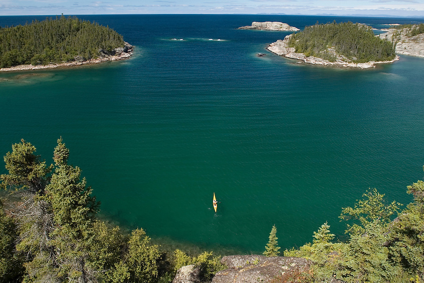 A lone sea kayak on Lake Superior as seen from above while paddling the shoreline of Pukaskwa Nationa Park Ontario Canada.
