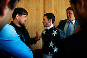 """Chechen President Ramzan Kadyrov gives a pep talk to the rider of his horse shortly before a race in Moscow's Hippodrome. .Kadyrov's horse, """"Royal Quiet"""", came first in the 1600-metre race. .The horse, born in the U.S.A., is parented by father: Real Quiet, mother: Dinasoar, is trained by S. G. Kolesnikov and rode by master jockey S. V. Petin."""