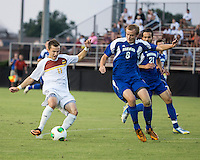 Winthrop University Eagles vs the Brevard College Tornados at Eagle's Field in Rock Hill, SC.  The Eagles beat the Tornados 6-0.  Patrick Barnes (11) takes a shot for the third goal of the game for Winthrop in the 9th minute.