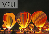 Inflating hot air balloons.