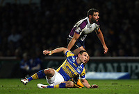 PICTURE BY VAUGHN RIDLEY/SWPIX.COM - Rugby League - 2013 World Club Challenge - Leeds Rhinos v Melbourne Storm - Headingley, Leeds, England - 22/02/13 - Leeds Kevin Sinfield and Melbourne's Cameron Smith.