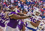 19 October 2014: Minnesota Vikings tackle Phil Loadholt is strong armed by Buffalo Bills defensive end Jarius Wynn (92) in the third quarter at Ralph Wilson Stadium in Orchard Park, NY. The Bills defeated the Vikings 17-16 in a dramatic, last minute, comeback touchdown drive. Mandatory Credit: Ed Wolfstein Photo *** RAW (NEF) Image File Available ***