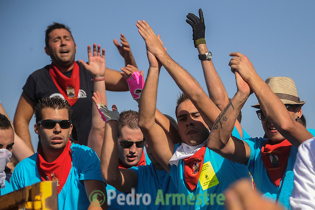 People applaud during the 'Toro de la Vega' festival, on September 11, 20112 in Tordesillas. The festival is one of the oldest in Spain with roots dating back to the fifteenth century. The bull has to be enticed across the river from the village to the plain 'Vega' before it can be killed to honour the 'Virgen de la Pena'. (c) Pedro ARMESTRE