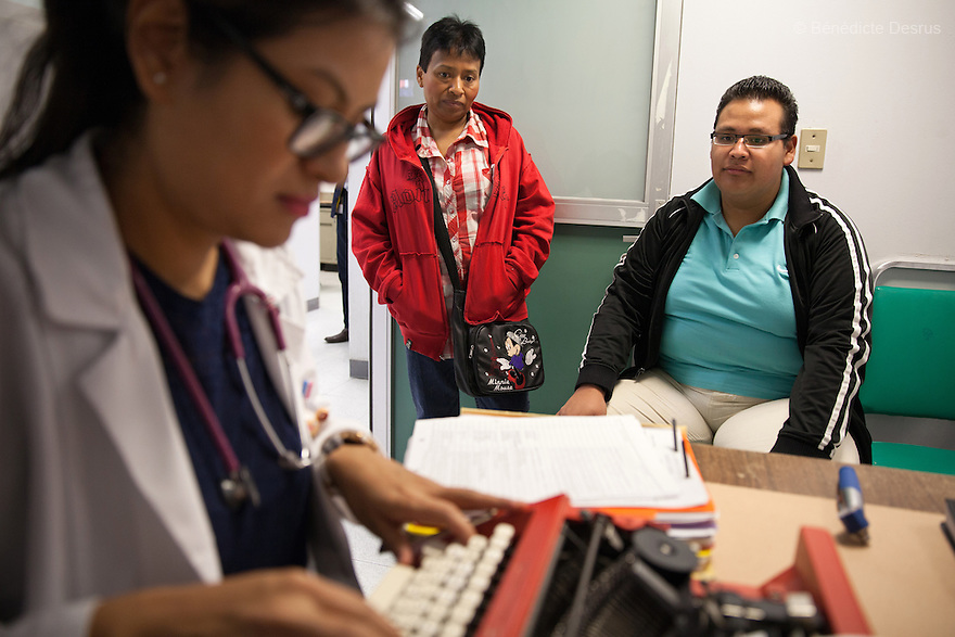 Oscar Reyes Meza (R), a seventeen year old Mexican boy, and his mother (C), attends a monthly consultation with doctors while being treated for health problems related to morbid obesity at the Federico Gomez Children's Hospital in Mexico City, Mexico on June 19, 2015. On December 2013, Oscar was first admitted to the hospital with diabetic ketoacidosis and weighed 264 pounds. He was diagnosed with diabetes mellitus type 2, Metabolic Syndrome, fatty liver disease, cholesterol, hypertriglyceridemia, Dyslipidemia, systemic arterial hypertension and started to use insulin injections to treat diabetes. On May 2015, Oscar weighed 312.4 pounds. As he applied to get bariatric surgery, Oscar has lost 26 pounds during this last month, and today weighs 288 pounds. Obesity has reached epidemic proportions globally. Mexico has one of the highest obesity rates in the world, and public health officials are increasingly alarmed by the rapid rise in child and youth obesity. Photo by Bénédicte Desrus