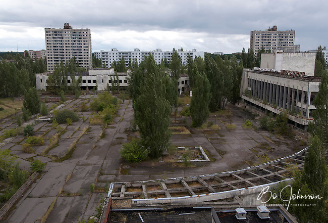 View over the central square from the deserted Hotel Polisye (Polissia?) in Pripyat. The central market and residential houses are across the square, and the Palace of Culture &quot;Energetik&quot; to the right.<br />