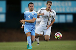 23 September 2016: North Carolina's Alex Comsia (CAN) (4) and Boston College's Maximilian Schulze-Geisthovel (GER) (12). The University of North Carolina Tar Heels hosted the Boston College Eagles in Chapel Hill, North Carolina in a 2016 NCAA Division I Men's Soccer match. UNC won the game 5-0.