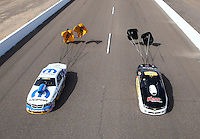 Feb 21, 2014; Chandler, AZ, USA; NHRA pro stock driver Allen Johnson (left) slows down alongside Rodger Brogdon during qualifying for the Carquest Auto Parts Nationals at Wild Horse Pass Motorsports Park. Mandatory Credit: Mark J. Rebilas-USA TODAY Sports