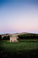 Rural setting in the Tuscany hills at twilight, near Volterra, Tuscany, Italy