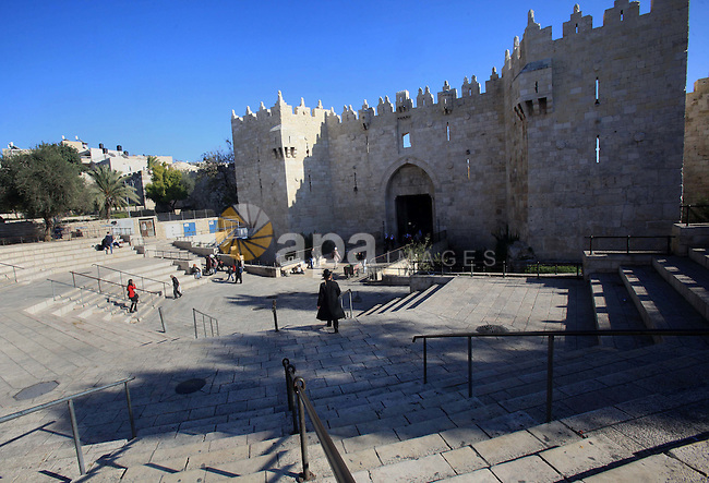 Palestinians walk in front of Damascus gate, in the Jerusalem's old city on Dec. 07, 2015. Photo by Mahfouz Abu Turk