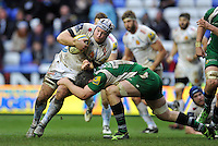 Thomas Waldrom of Exeter Chiefs is tackled by Rob McCusker of London Irish. Aviva Premiership match, between London Irish and Exeter Chiefs on February 21, 2016 at the Madejski Stadium in Reading, England. Photo by: Patrick Khachfe / JMP